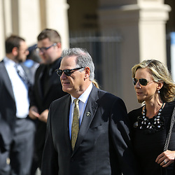 New Orleans Saints general manager Mickey Loomis and his wife Melanie Loomis arrive at the funeral service for NFL New Orleans Saints owner and NBA New Orleans Pelicans owner Tom Benson in New Orleans, Friday, March 23, 2018. Benson died last Thursday at the age of 90. (AP Photo/Derick Hingle)