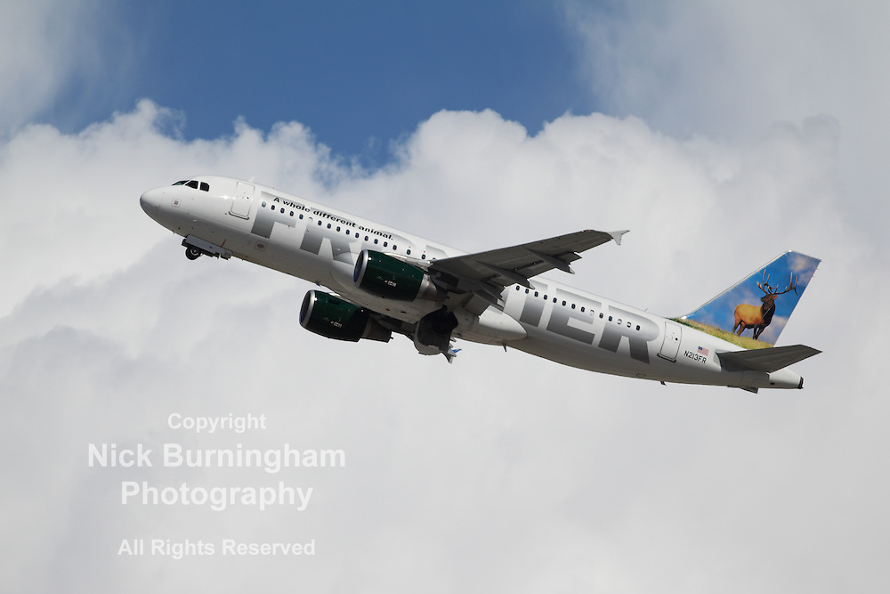 LOS ANGELES, CALIFORNIA, USA - MARCH 8, 2013 - Frontier Airlines Airbus A320-214 takes off from Los Angeles Airport on March 8, 2013. The plane has a range of 5,900 km with 150 seats.