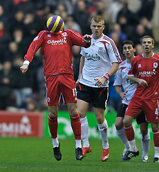 MIDDLESBROUGH, ENGLAND - Saturday, January 12, 2008: Liverpool's John Arne Riise and Middlesbrough's Tuncay Sanli during the Premiership match at the Riverside Stadium. (Photo by David Rawcliffe/Propaganda)