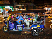 29 FEBRUARY 2016 - BANGKOK, THAILAND:  A tuk-tuk driver in front of the Bangkok flower market.  Many of the sidewalk vendors around Pak Khlong Talat, the Bangkok flower market, closed their stalls Monday. As a part of the military government sponsored initiative to clean up Bangkok, city officials announced new rules for the sidewalk vendors that shortened their hours and changed the regulations they worked under. Some vendors said the new rules were confusing and too limiting and most vendors chose to close Monday rather than risk fines and penalties. Many hope to reopen when the situation is clarified.   PHOTO BY JACK KURTZ
