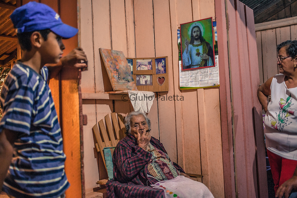 Pedro Juan Caballero - Ponta Porã, MS, border Paraguay - Brazil. Cristina, 102 years old, Paraguayan. She worked for more than 40 years as obstetrician in the small town of Sanga Puita, on the Paraguayan side of the border, helping giving birth to over 2300 babies. She created a unique and numerous mixed Paraguayan and Brazilian family.