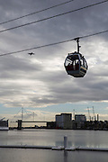 An Emirates Air Line Cable Car takes passengers across the River Thames between Greenwich Peninsula and the Royal Docks in London, England, United Kingdom. The Royal Victoria Bridge can be seen in the background. (photo by Andrew Aitchison / In pictures via Getty Images)