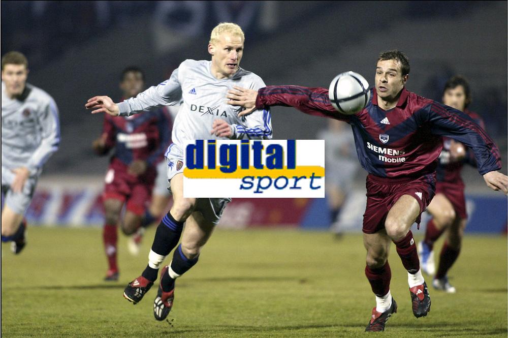 BORDEAUX, (FRA) 11/03/2004<br /> SPORT / FOOTBALL / VOETBAL /<br /> 1/8 FINALE UEFA BEKER CLUB BRUGGE - F.C. BORDEAUX / 1/8 FINALE FC BRUGES - F.C. GIRONDINS DE BORDEAUX /<br /> RUNE LANGE - JURIETTI /<br /> PICTURE BY NICO VEREECKEN<br /> DIGITALSPORT
