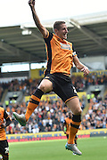 Michael Dawson  celebrates scoring the equalising goal to go 1-1 for Hull City  during the Sky Bet Championship match between Hull City and Queens Park Rangers at the KC Stadium, Kingston upon Hull, England on 19 September 2015. Photo by Ian Lyall.