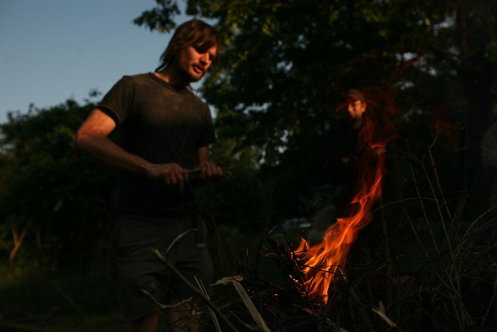 Pittsboro, NC - May 13: Noel and Grey work at making bio-char at  the farm at Circle Acres. (Photo by Logan Mock-Bunting)