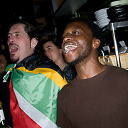 Date: 6/11/10..Fans chant the South African national anthem while watching the 2010 World Cup opening Group A match between South Africa and Mexico at Madiba, a South African restaurant in Fort Greene, Brooklyn on June 11, 2010.   The game finished in a 1-1 tie. ..Photo by Angela Jimenez for Newsweek .photographer contact 917-586-0916/angelajime@gmail.com