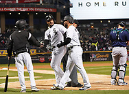 CHICAGO - APRIL 23:  Jose Abreu #79 celebrates with Yoan Moncada #10 of the Chicago White Sox after Abreu hit a home run against the Seattle Mariners on April 23, 2018 at Guaranteed Rate Field in Chicago, Illinois.  (Photo by Ron Vesely)   Subject:   Jose Abreu, Yoan Moncada