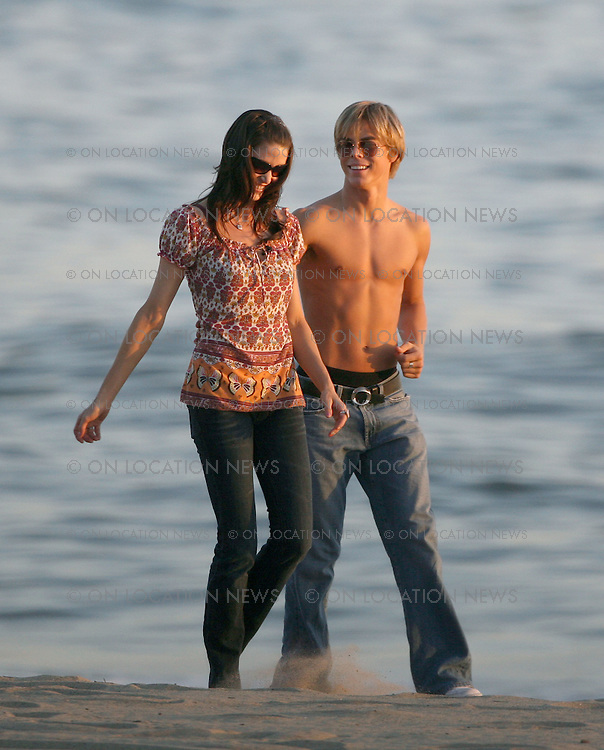 MALIBU, CALIFORNIA - THURSDAY 17TH APRIL 2008. ***EXCLUSIVE *** Dancing With The Stars Shannon Elizabeth and her professional dance partner Derek Hough show off some of their dance moves for a small TV crew. The dancers played with hoops, frolicked in the sand and had great chemistry together. Once the TV crew had left it became clear that Shannon and Derek are romantically involved with each other. Once they were alone alone, the adorable new couple cuddled and kissed and took pictures as they watched a beautiful California sunset. Shannon Elizabeth is 34 while her new boyfriend Derek is only 22 ! Derek is American born but based in London. Official Biography for Derek Hough is found here: http://abc.go.com/primetime/dancingwiththestars/index?pn=bios#t=pro&d=23271..Photograph by On Location News. Sales: Eric Ford 1/818-613-3955 info@OnLocationNews.com..