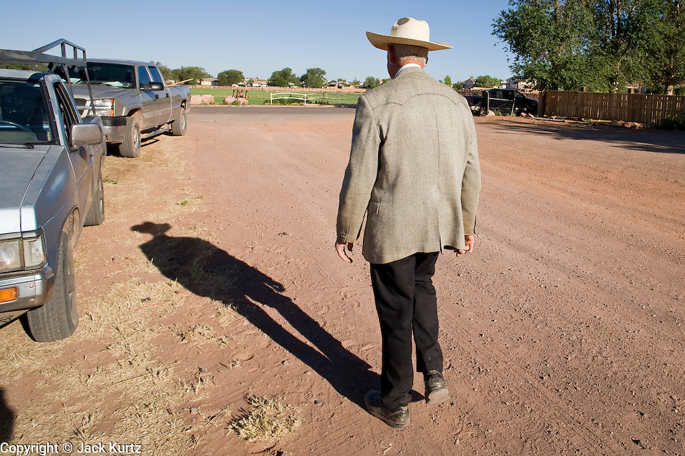 "June 16, 2008 -- COLORADO CITY, AZ: JOSEPH JESSOP, 86 years old, walks down a street in Colorado City, AZ. Jessop, a polygamist and member of the FLDS, was arrested during the Short Creek Raid in 1953 and had his wives and children taken from him for two years. Colorado City and neighboring town of Hildale, UT, are home to the Fundamentalist Church of Jesus Christ of Latter Day Saints (FLDS) which split from the mainstream Church of Jesus Christ of Latter Day Saints (Mormons) after the Mormons banned plural marriage (polygamy) in 1890 so that Utah could gain statehood into the United States. The FLDS Prophet (leader), Warren Jeffs, has been convicted in Utah of ""rape as an accomplice"" for arranging the marriage of teenage girl to her cousin and is currently on trial for similar, those less serious, charges in Arizona. After Texas child protection authorities raided the Yearning for Zion Ranch, (the FLDS compound in Eldorado, TX) many members of the FLDS community in Colorado City/Hildale fear either Arizona or Utah authorities could raid their homes in the same way. Older members of the community still remember the Short Creek Raid of 1953 when Arizona authorities using National Guard troops, raided the community, arresting the men and placing women and children in ""protective"" custody. After two years in foster care, the women and children returned to their homes. After the raid, the FLDS Church eliminated any connection to the ""Short Creek raid"" by renaming their town Colorado City in Arizona and Hildale in Utah.  Photo by Jack Kurtz / ZUMA Press"