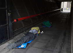 Homeless sleeping this morning in Central London. A group of three homeless sleep together with sleeping bags this morning in one of the corridors at Southbank Centre, London, United Kingdom. Friday, 4th April 2014. Picture by Daniel Leal-Olivas / i-Images