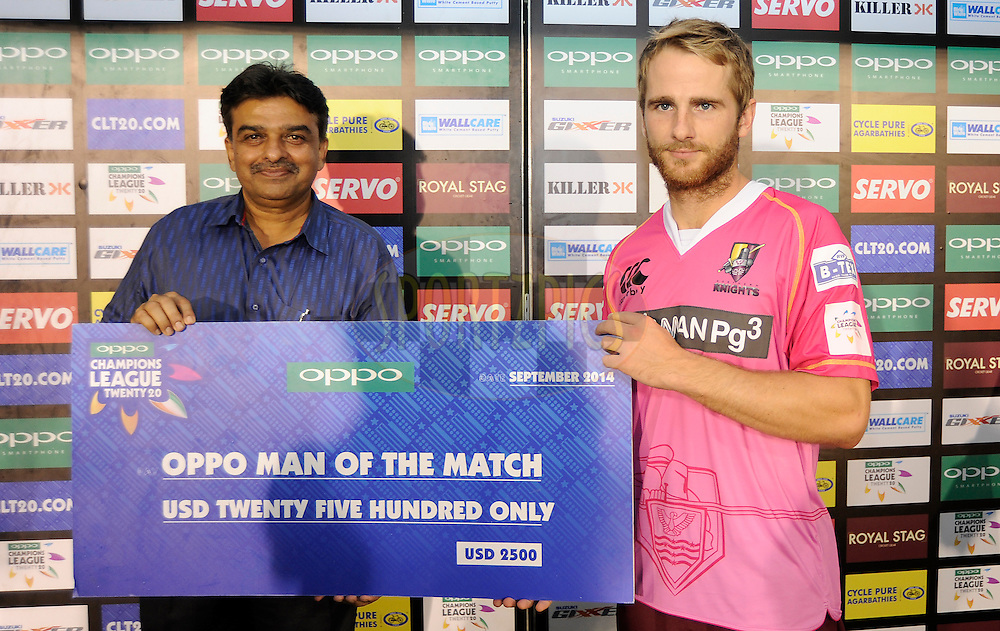 Kane Williamson of Northern Knights receives the Oppo man of  match award during match 3 of the Oppo Champions League Twenty20 between the Cape Cobras and the Northern Knights held at the Chhattisgarh International Cricket Stadium, Raipur, India on the 19th September 2014<br /> <br /> Photo by:  Pal Pillai / Sportzpics/ CLT20<br /> <br /> <br /> Image use is subject to the terms and conditions as laid out by the BCCI/ CLT20.  The terms and conditions can be downloaded here:<br /> <br /> http://sportzpics.photoshelter.com/gallery/CLT20-Image-Terms-and-Conditions-2014/G0000IfNJn535VPU/C0000QhhKadWcjYs