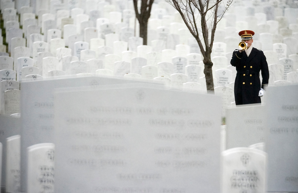 A U.S. Army Honor Guard member plays Taps during the funeral of Cpl. Luke Runyan Monday, March 10, 2008. Cpl. Runyan, a Spring Grove Area High graduate, was laid to rest in Arlington National Cemetery...John Pavoncello photo........