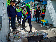 23 AUGUST 2017 - BANGKOK, THAILAND: City workers take apart a concrete post in Pom Mahakan. Bangkok city officials this week started cleaning up the area around cremation site for Bhumibol Adulyadej, the Late King of Thailand. Work started by cleaning Pom Mahakan, a historic fort about two kilometers northeast of the cremation site. They are going to scrub and paint the fort's historic exterior walls, which were built in the late 18th century. The King, who died on 13 October 2016, will be cremated on 26 October 2017.      PHOTO BY JACK KURTZ