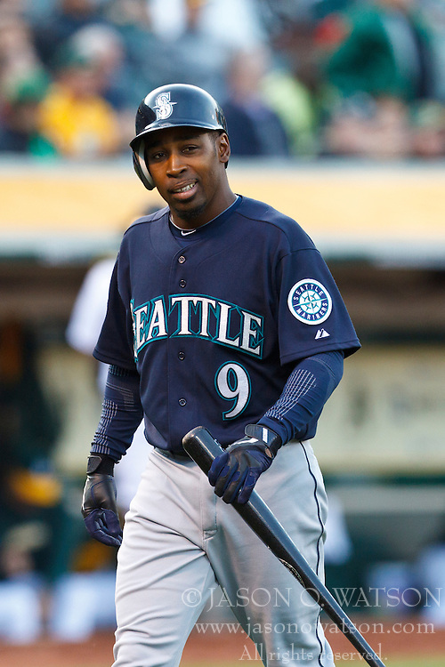 OAKLAND, CA - APRIL 07: Chone Figgins #9 of the Seattle Mariners returns to the dugout after striking out against the Oakland Athletics during the third inning at O.co Coliseum on April 7, 2012 in Oakland, California. The Seattle Mariners defeated the Oakland Athletics 8-7. (Photo by Jason O. Watson/Getty Images) *** Local Caption *** Chone Figgins