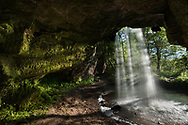 A summer night's sunshine lights up the cave behind Scott Falls - Michigan's Upper Peninsula