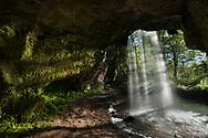 A summer night's sunshine lights up the cave behind Scott Falls - Michigan's Upper Peninsula