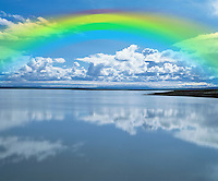Rainbow over calm lake