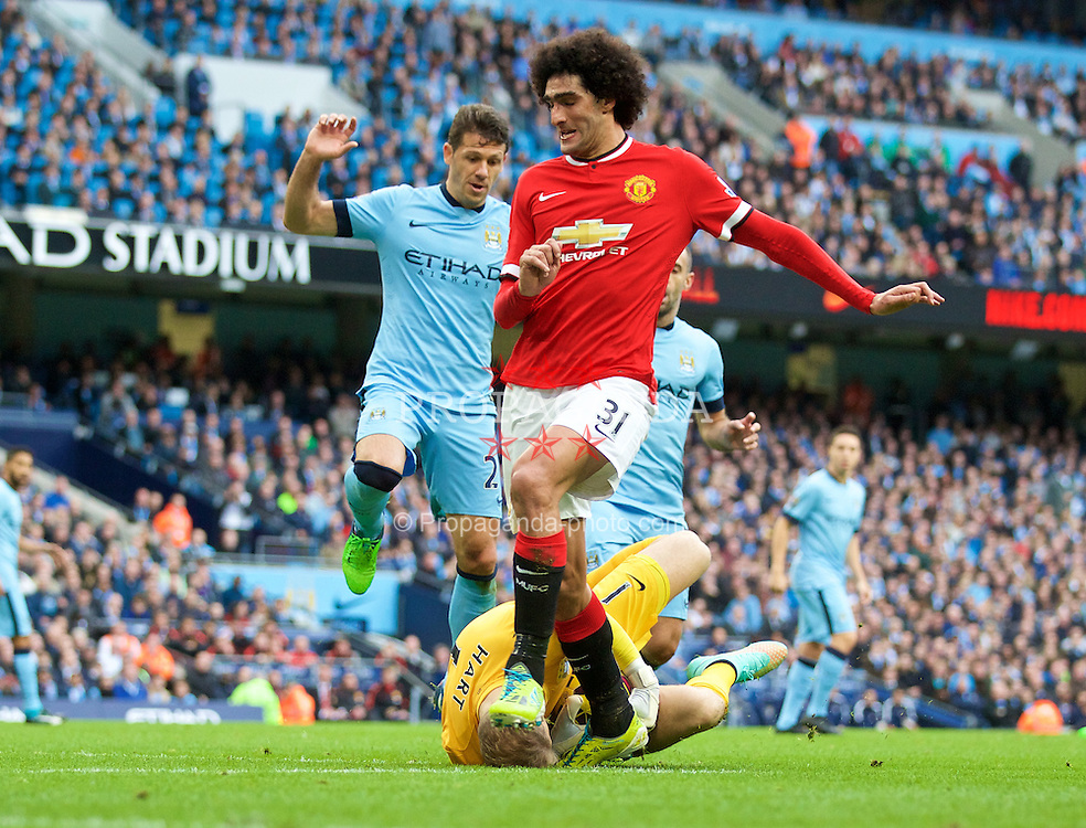 MANCHESTER, ENGLAND - Sunday, November 2, 2014: Manchester City's goalkeeper Joe Hart saves at the feet of Manchester United's Marouane Fellaini during the Premier League match at the City of Manchester Stadium. (Pic by David Rawcliffe/Propaganda)