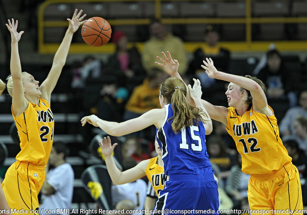 December 20, 2011: Iowa Hawkeyes guard Jaime Printy (24), Drake Bulldogs forward Rachael Hackbarth (15), and Iowa Hawkeyes center Morgan Johnson (12) try to grab a rebound during the NCAA women's basketball game between the Drake Bulldogs and the Iowa Hawkeyes at Carver-Hawkeye Arena in Iowa City, Iowa on Tuesday, December 20, 2011. Iowa defeated Drake 71-46.