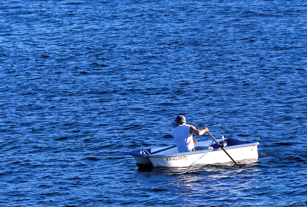 A man in a rowboat.