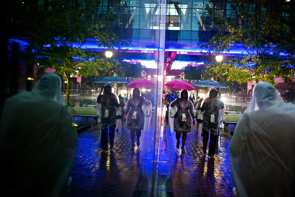 Attendees try to stay dry in the rain as they head inside on the first night of the 2012 Democratic National Convention in Charlotte, N.C. on Sept. 4, 2012. Photo by Greg Kahn