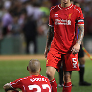 Martin Skrtel, (seated) and Daniel Agger. Liverpool, after their sides 1-0 defeat during the Liverpool Vs AS Roma friendly pre season football match at Fenway Park, Boston. USA. 23rd July 2014. Photo Tim Clayton