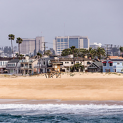 Picture of Newport Beach California oceanfront homes and office buildings. Newport Beach is a wealthy beach community along the Pacific Ocean in Orange County Southern California.