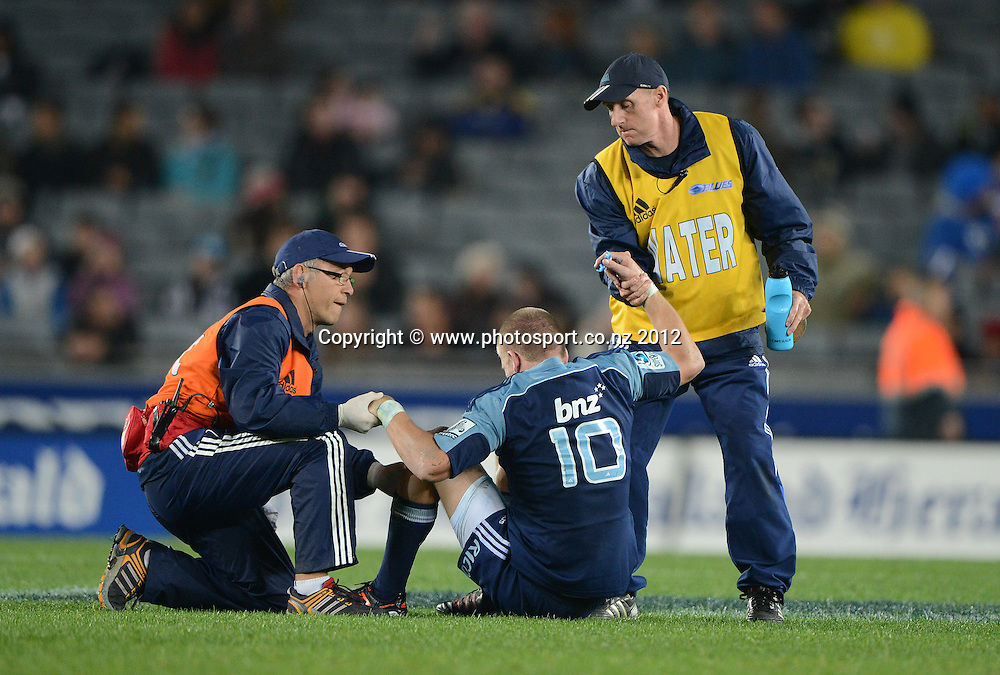 Dr Stephen Kara tends to an injured Gareth Anscombe during the Blues and Highlanders at Eden Park, Auckland, New Zealand on Saturday 26 May 2012. Photo: Andrew Cornaga/Photosport.co.nz