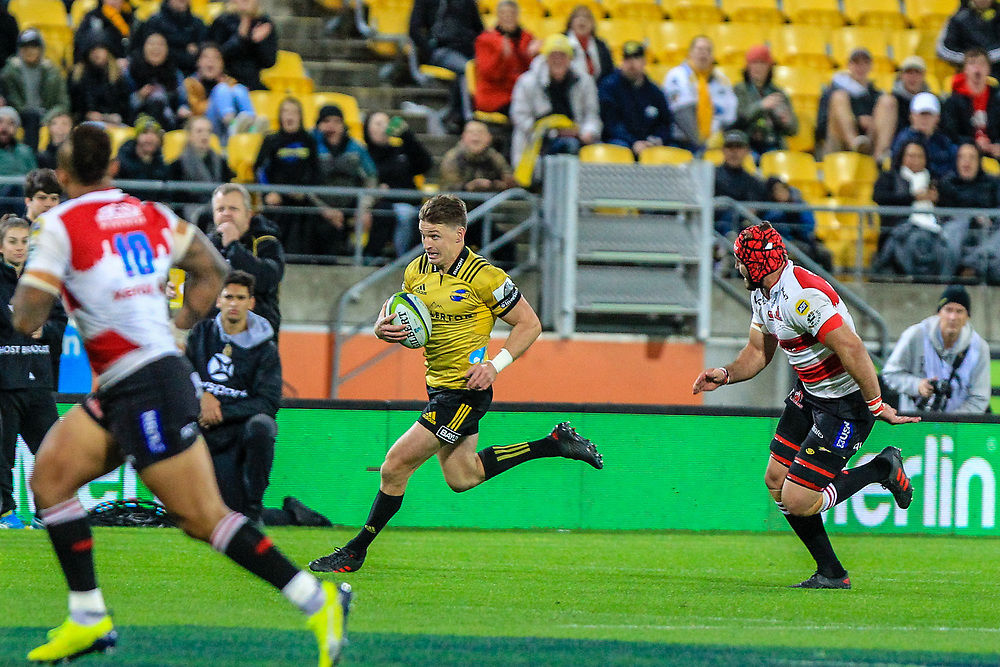 Beauden Barrett runs with the ball during the Super rugby (Round 12) match played between Hurricanes  v Lions, at Westpac Stadium, Wellington, New Zealand, on 5 May 2018.  Hurricanes won 28-19.