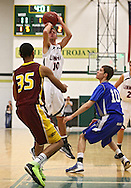 Linn-Mar's Matt Lassen (10) puts up a shot over Mt Pleasant's Faith Pope (35) and Danville's Michael Soukup (10) during the 2013 Eastern Iowa All-Star Basketball Game at Iowa City West High School in Iowa City on Wednesday, March 27, 2013. The South (dark) defeated the North (white) 87-79.