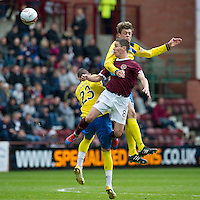 Hearts v St Johnstone....06.05.12   SPL<br /> Murray Davidson gets above Ian Black<br /> Picture by Graeme Hart.<br /> Copyright Perthshire Picture Agency<br /> Tel: 01738 623350  Mobile: 07990 594431