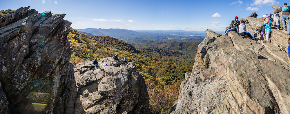 Hike to expansive views of the Shenandoah Valley on the popular Humpback Rocks Trail (2 miles round trip with 700 feet gain) from Milepost 6 on the Blue Ridge Parkway of Virginia, in the Blue Ridge Mountains (a subset of the Appalachian Mountains), USA. Optionally connect to longer loops of 3 to 7 miles, or to the 2182-mile Appalachian Trail. At adjacent Parkway Milepost 5.8, explore the restored 1890s Humpback Rocks Mountain Farm. The scenic 469-mile Blue Ridge Parkway was built 1935-1987 to aesthetically connect Shenandoah National Park (in Virginia) with Great Smoky Mountains National Park in North Carolina, following crestlines and the Appalachian Trail. This panorama was stitched from 9 overlapping photos.