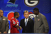 Show host Pat Sajak with Tampa Bay Buccaneers wide receiver Keyshawn Johnson and a contestant at NFL Players Week on Wheel of Fortune on 11/04/2003. ©Paul Anthony Spinelli