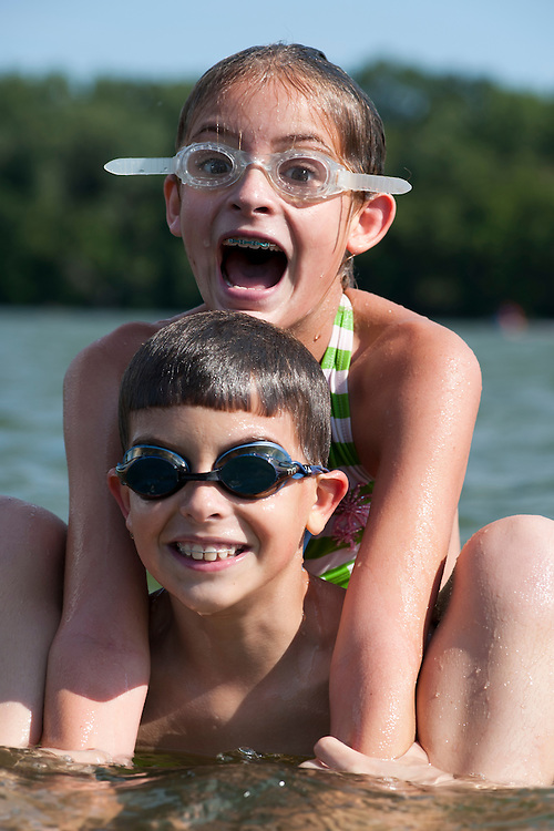 Eleven-year-old twins Jackson and Zoe Eilers swim with friends in a lake near their family's home in Minneapolis, Minn., on Aug. 31, 2008.