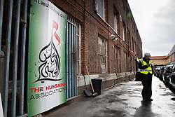 © Licensed to London News Pictures. 19/09/2018. London, UK. A private security guard stands at the entrance to The Hussaini Association Islamic Centre in Cricklewood, north London where a car hit two pedestrians last night. The incident , which took place in the early hours of this morning outside the centre, is being treated as a possible hate crime. Police are looking for a male driver who failed to stop at the scene, as well as two men and one woman in the car, all in their 20s. Photo credit: Peter Macdiarmid/LNP