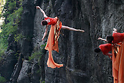 "ZHANGJIAJIE, CHINA - SEPTEMBER 12: <br /> <br /> Dancers Hang On Cliff To Perform <br /> <br /> Dancers from American Bandaloop dance troupe hang from the plank road on Guigu Cliff to perform in the air at Tianmenshan National Forest Park on September 12, 2016 in Zhangjiajie, Hunan Province of China. Bandaloop dance troupe made performances in the air at Tianmenshan National Forest Park on Sep 12-13 in Zhangjiajie. Dancers hung on Guigu Cliff, Tianmen Cave and Yuhu Peak to perform the ""vertical dance\"". <br /> ©Exclusivepix Media"