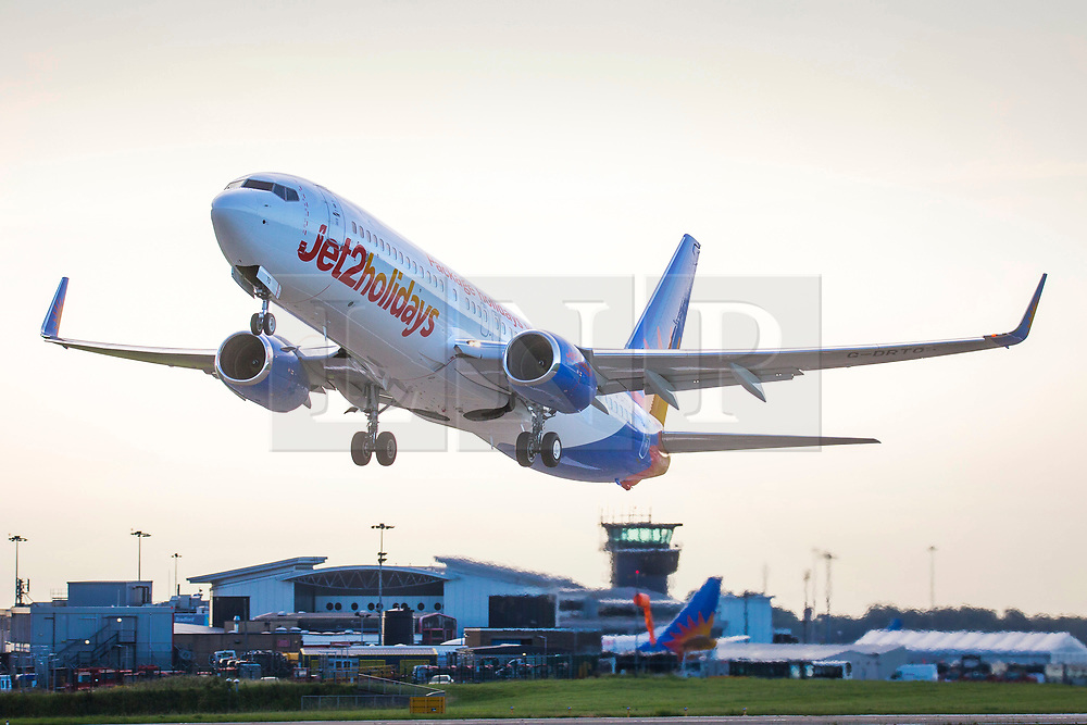 © Licensed to London News Pictures. 08/08/2020. Leeds UK. A Jet2 aircraft leaves Leeds Bradford Airport this morning in Yorkshire. Jet2 has announced that flights & holidays to the Balearic & Canary Islands up to & including 15th August have now been suspended, Jet2 had already suspended travel to mainland Spain, with flights and holidays also cancelled until at least August 17 - including to destinations such as Malaga, Alicante and Costa de Almeria. Photo credit: Andrew McCaren/LNP