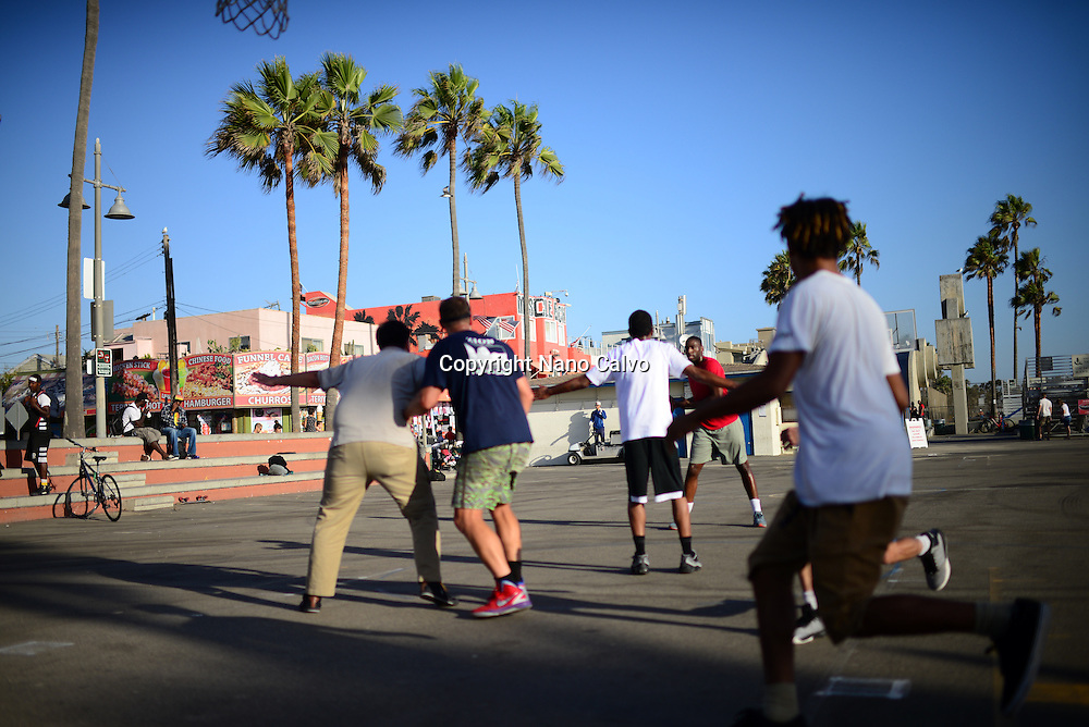 Street basketball game in Venice Beach, Los Angeles, California.