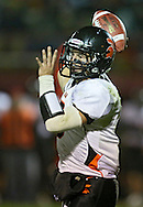 Solon's Rory Siddell (5) passes the ball during the first half of the game between the Solon Spartans and the Marion Indians at Thomas Park Field in Marion on Friday evening, October 5, 2012.