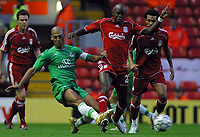 Photo: Paul Thomas.<br /> Liverpool v Maccabi Haifa. UEFA Champions League Qualifier. 09/08/2006.<br /> <br /> Momo Sissoko of Liverpool tackles Yaniv Katan (L).