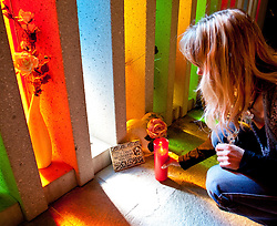 """11.10.2010, Gedenkstätte, Kaprun, AUT, 10 Jahre Kaprun Katastrophe, Features, am 11.11. 2010 jährt sich die Brandkatastrophe von Kaprun das 10. Mal. Bei diesem Unglück mussten 155 Menschen ihr Leben lassen, im Bild Innenansicht der Gedenkstätte am Fusse des Kitzsteinhorns in Kaprun, eine weibliche Person stellt eine Kerze vor einer Tafel mit der Aufschrift """"Du lebst in unseren Herzen"""" nieder, EXPA Pictures © 2010, PhotoCredit: EXPA/ J. Feichter / SPORTIDA PHOTO AGENCY"""
