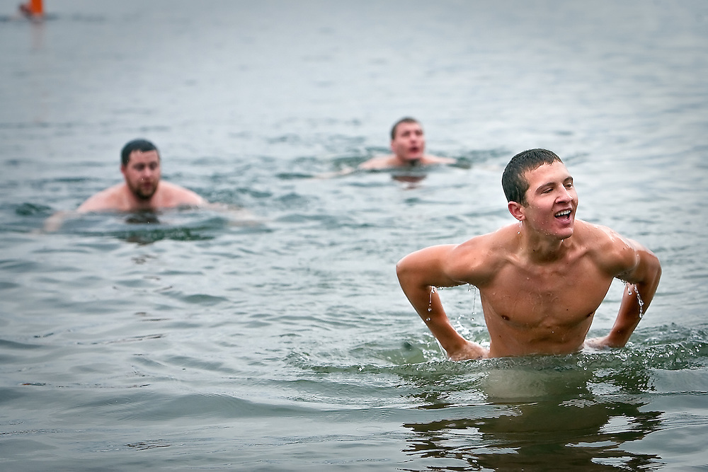 "JEROME A. POLLOS/Press..Ryan Agostinelli walks up to the shore after racing Sean Baines, left, and Aaron Agostinelli to a buoy following the initial wave of Polar Bear ""plungers."""