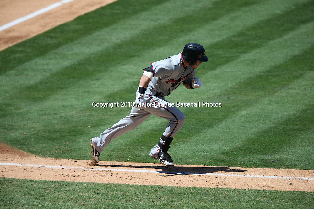 ANAHEIM, CA - JULY 24:  Chris Herrmann #12 of the Minnesota Twins runs to first base as he grounds out for the first out in the top of the 5th inning during the game against the Los Angeles Angels of Anaheim on Wednesday, July 24, 2013 at Angel Stadium in Anaheim, California. The Angels won the game in a 1-0 shutout. (Photo by Paul Spinelli/MLB Photos via Getty Images) *** Local Caption *** Chris Herrmann