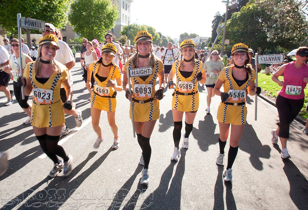 """A group of San Mateo women who billed themselves as the """"San Francisco Taxi Girls"""" run along Fell Street at the 98th Bay to Breakers footrace through San Francisco, Sunday, May 17, 2009. They are, from left, Stephanie Donohue, Parisa Voigt, Tarah Balden, Katie Olivier and Katie Wolfe. (Photo by D. Ross Cameron)"""