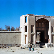 25 November 1976<br /> Kabul. This complex consists of a mosque/madrass, a spacious courtyard and the mausoleum H Ansari (1727-1812). His ancestors moved from Saudia Arabia to Herat in the mid 7th century and later settled in the near-by village of Deh Yaha where he was born. He was brouth before Ahmad Shah Durrani for holding unorthodox ideas, but his brilliant defense so confounded the leading theologians that his death sentence was overruled. Many disciples flocked to his Madrassa. <br /> The major buildings were built on order of his chief murid (disciple), Mir Ahmad Khan Mardanzai, the celebrated governor of Kashmir.
