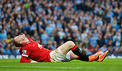 MANCHESTER, ENGLAND - Sunday, November 2, 2014: Manchester United's Wayne Rooney clutches his left leg after sustaining an injury during the Premier League match against Manchester City at the City of Manchester Stadium. (Pic by David Rawcliffe/Propaganda)