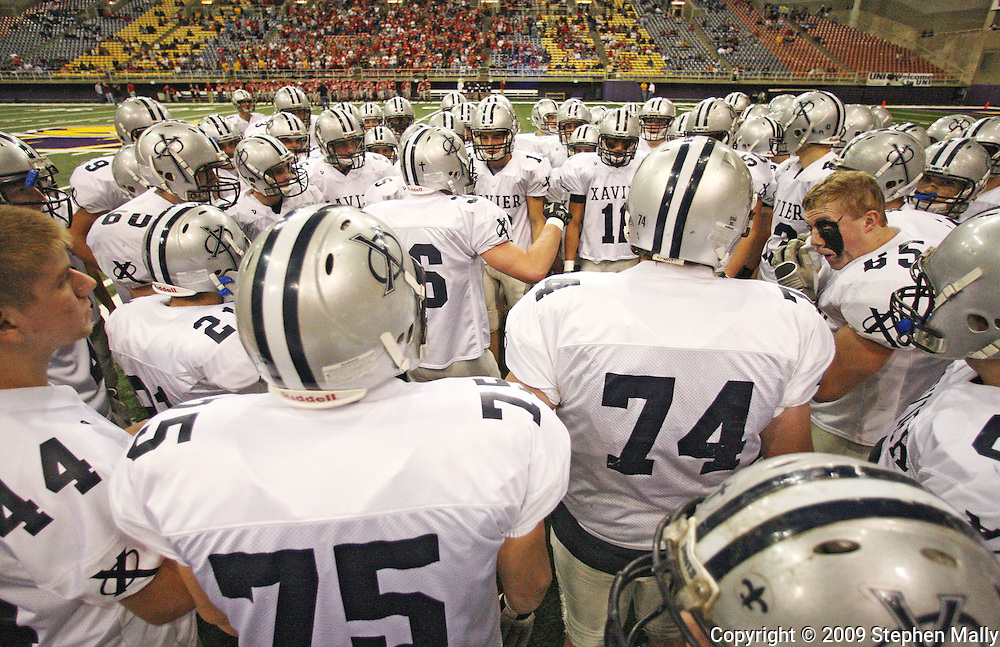 Xavier huddles together before their Class 4A semifinal game at the UNI Dome in Cedar Falls on Friday November 13, 2009.
