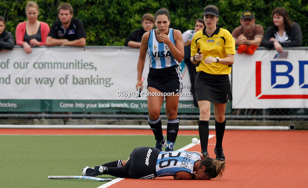 Gisella Kanevsky of Argentina lies on the ground holding her face during the Black Sticks Woman v Argentina International Hockey match. Rosvall ITM Hockey Stadium, Whangarei, New Zealand 26 March 2011. Photo: Kenny Rodger/ photosport.co.nz