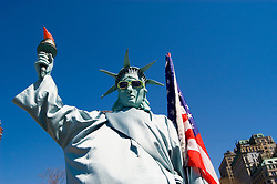 New York City, New York: Street entertainer as Statue of Liberty, in Battery Park.  .Photo #: ny210-14802  .Photo copyright Lee Foster, www.fostertravel.com, lee@fostertravel.com, 510-549-2202.
