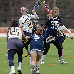 Staff photos by Tom Kelly IV<br /> Notre Dame's Caroline Ailen (21) and Episcopal's Brooke Baxter (35) face off during the Episcopal Academy at Notre Dame girls lacrosse game on Tuesday afternoon, March 31, 2015.